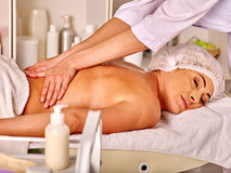 Woman middle-aged in spa salon with beautician. Royalty Free Stock Image