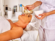 Woman middle-aged in spa salon with beautician Stock Photo
