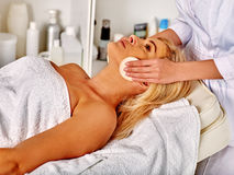 Woman middle-aged in spa salon with beautician Stock Image