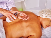 Woman middle-aged in spa salon with beautician Stock Images