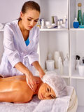 Woman middle-aged in spa salon with beautician. Stock Image