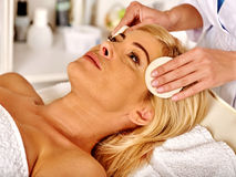 Woman middle-aged in spa salon and beautician Stock Photos