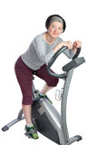 Woman, middle-aged on a stationary bike. Stock Image