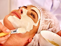 Woman middle-aged take face massage in spa salon Royalty Free Stock Image