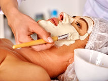 Woman middle-aged take face massage in spa salon Royalty Free Stock Images