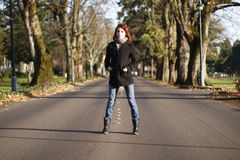 Woman in the middle of the road Stock Image