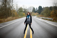 Woman in the middle of the road Stock Photos