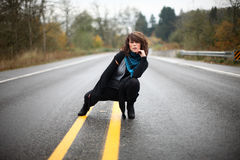 Woman in the middle of the road Royalty Free Stock Photo