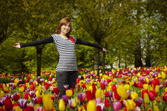 Woman in the middle of tulips Royalty Free Stock Photography