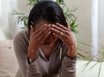 Woman migrain. African-american woman suffering headache symptom. Health problem stock photo