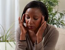 Woman migrain. African-american woman suffering headache symptom. Health problem royalty free stock image