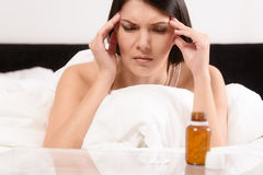 Woman with a migraine headache Stock Photos