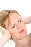 Woman with a migraine holding her head Royalty Free Stock Photography