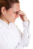 Woman with migraine massaging Royalty Free Stock Photos