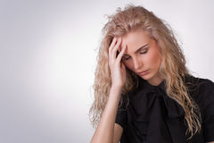 Woman with a migrane headache Royalty Free Stock Photo