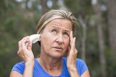 Woman migrane headache tissue in ear Royalty Free Stock Image
