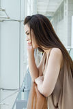 Woman with mild stress, worry and unhappiness Stock Photo