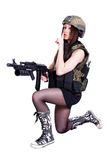 Woman in a military camouflage sitting with the assault rifle Royalty Free Stock Photography