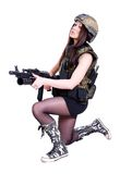 Woman in a military camouflage sitting with the assault rifle Royalty Free Stock Photo