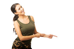 Woman in military clothes pointing to the right Stock Photography