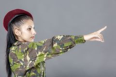 Woman in military clothes pointing Stock Image