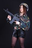 Woman in the military uniform with an assault rifle Stock Image