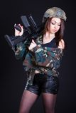 Woman in the military uniform with an assault rifle Stock Photo