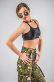 woman in military uniform camouflage sports Stock Photos