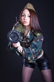 Woman in the military uniform with a grenade launcher Stock Photography