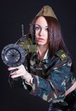 Woman in the military uniform with a grenade launcher Royalty Free Stock Images