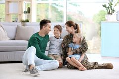 Woman in military uniform with her family royalty free stock photos