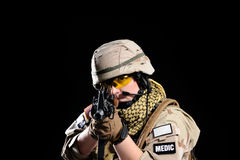 Woman in military uniform with weapon Royalty Free Stock Photos