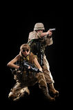 Woman in military uniform with weapon Royalty Free Stock Photo