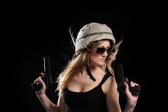 Woman in military uniform with weapon Royalty Free Stock Image