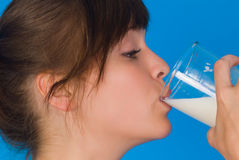 Woman with milk. Woman with a glass of milk Royalty Free Stock Images