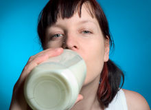 Woman with milk Royalty Free Stock Image