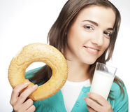 Woman with milk and donut Royalty Free Stock Images