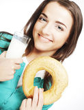 Woman with milk and donut Stock Image