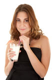 Woman with milk shake. Beautiful woman in black dress is holding glass with white drink royalty free stock image