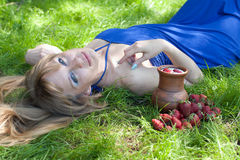The woman with milk and a strawberry Royalty Free Stock Photos