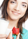 Woman with milk and strawberry Stock Images