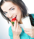 Woman with milk and strawberry Royalty Free Stock Photos