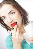 Woman with milk and strawberry Stock Photography