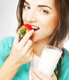 Woman with milk and strawberry Royalty Free Stock Photo
