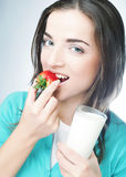 Woman with milk and strawberry Stock Photo