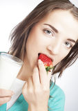 Woman with milk and strawberry Royalty Free Stock Images