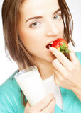 Woman with milk and strawberry Royalty Free Stock Image