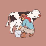 Woman milking cow Royalty Free Stock Images