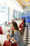 Woman with the milkshake at the diner. Woman with the milkshake in the the diner Stock Image