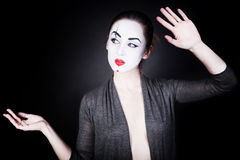 Woman in mime make-up dancing Royalty Free Stock Photos
